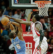 April 16, 2012; Houston, TX, USA; Houston Rockets center Samuel Dalembert (21) blocks Denver Nuggets shooting guard Arron Afflalo (6) during the first quarter at the Toyota Center. The Nuggets won 105-102. Mandatory Credit: Thomas Campbell-US PRESSWIRE