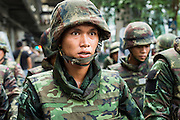 25 MAY 2014 - BANGKOK, THAILAND: A Thai soldier on the street in Bangkok. They were enroute a demonstration against the coup. Public opposition to the military coup in Thailand grew Sunday with thousands of protestors gathering at locations throughout Bangkok to call for a return of civilian rule and end to the military junta.     PHOTO BY JACK KURTZ