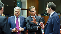 Jyrki Katainen, Finland's finance minister, center, speaks with George Osborne, the UK's chancellor of the exchequer,  right, and Didier Reynders, Belgium's finance minister, during a meeting of EU finance ministers, at the European Council headquarters, in Brussels, Tuesday, Dec. 7, 2010. (Photo © Jock Fistick).