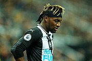 Allan Saint-Maximin (#10) of Newcastle United looks on as Jetro Willems (#15) of Newcastle United receives treatment during the Premier League match between Newcastle United and Chelsea at St. James's Park, Newcastle, England on 18 January 2020.