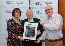 Kilteevan tidy towns County endeavour winner at the North West and West Region Awards ceremony collecting their prize from Minister of State for Rural development Michael Ring TD.<br />