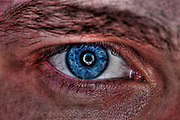 Extreme closeup of a human eye - blue