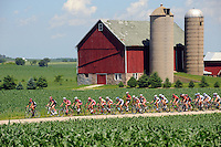 Racers, fans and support staff compete in the 95-degree heat during the Tour of America's Dairyland road race that took place on the country roads East of Fond du Lac. Tuesday, June 23, 2009. The reporter photo by Patrick Flood.