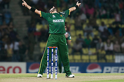 © Licensed to London News Pictures. 25/09/2012. Pakistan bowler Shahid Afridi celebrates after getting the wicket of Mahmudullah during the T20 Cricket World T20 match between Pakistan Vs Bangladesh at the Pallekele International Stadium Cricket Stadium, Pallekele. Photo credit : Asanka Brendon Ratnayake/LNP