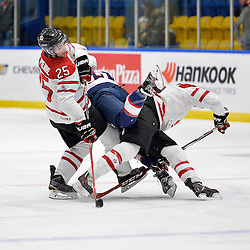 WHITBY, - Dec 18, 2015 -  Game #12 - Bronze Medal Game, Team Canada East vs. United States at the 2015 World Junior A Challenge at the Iroquois Park Recreation Complex, ON. Maxime St. Pierre #25 of Team Canada East gets tangled with Ross Colton #22 of Team United States and another Team Canada East player during the second period.<br /> (Photo: Shawn Muir / OJHL Images)