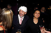 Christian Louboutin and Aisha Nadar, party given by Daphne Guinness for Christian Louboutin  after the opening of his new shopt.  Baglione Hotel. 16 March 2004.  ONE TIME USE ONLY - DO NOT ARCHIVE  © Copyright Photograph by Dafydd Jones 66 Stockwell Park Rd. London SW9 0DA Tel 020 7733 0108 www.dafjones.com