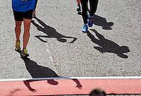 Finish line shadows<br /> The Virgin Money London Marathon 2014<br /> 13 April 2014<br /> Photo: Javier Garcia/Virgin Money London Marathon<br /> media@london-marathon.co.uk