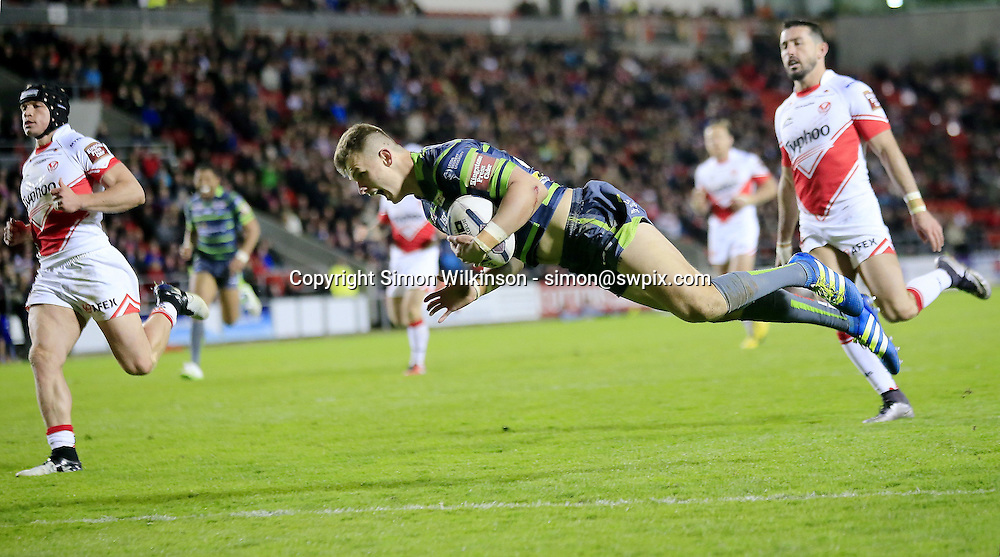 Picture by Chris Mangnall/SWpix.com - 22/04/2016 - Rugby League - First Utility Super League - St Helens Saints v Leeds Rhinos - Langtree Park Stadium, St Helens, England<br /> Leeds 4th try scorer Ash Handley scores