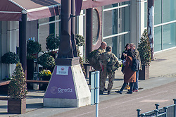 © Licensed to London News Pictures. 26/03/2020. London, UK. People, including military personnel, arrive at the ExCeL London exhibition centre. The huge exhibition centre in London is to be used as a field hospital during the COVID-19 coronavirus pandemic. Photo credit: Peter Manning/LNP