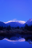Cabinet Mountains and Bull River at twilight in fall. Bull River Valley, northwest Montana