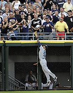 CHICAGO - JUNE 06:  Greg Halman #56 of the Seattle Mariners leaps but cannot catch the home run ball hit by Paul Konerko #14 of the Chicago White Sox in the fourth inning on June 6, 2011 at U.S. Cellular Field in Chicago, Illinois.  The White Sox defeated the Mariners 3-1.  (Photo by Ron Vesely)  Subject:  Greg Halman;Paul Konerko
