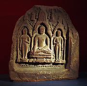 The Buddha, terracotta plaque, Bodhgaya, 1000-1100.  The Buddha, flanked by attendant Buddha's, makes the earth-touching gesture.
