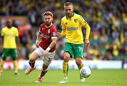 Matty Taylor of Bristol City chases down Tom Trybull of Norwich City - Mandatory by-line: Robbie Stephenson/JMP - 23/09/2017 - FOOTBALL - Carrow Road - Norwich, England - Norwich City v Bristol City - Sky Bet Championship
