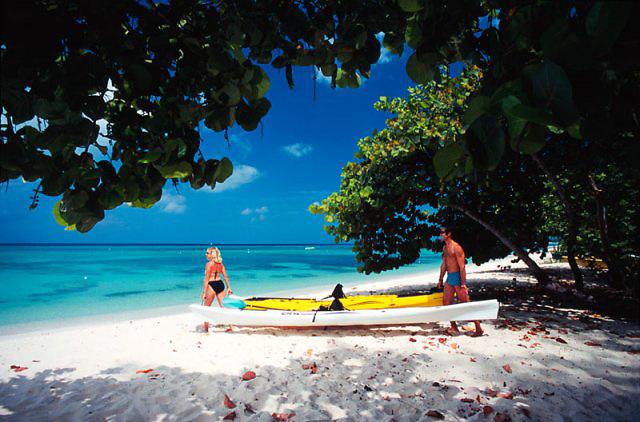 Commercial advertising image of kayaking on Seven Mile Beach for Cobra Kayaks brochure, shot on film