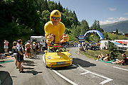 Before the actual Tour de France arrives the caravan of publicity vehicles passes through about an hour in front