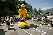 Before the actual Tour de France arrives the caravan of publicity vehicles passes through about an hour in front