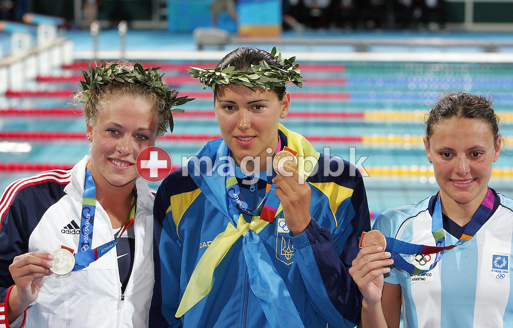 Ukraine swimmer Jana Klochkova (C) jubilates with her gold medal next to silver medalist Kaitlin Sandeno from USA (L) and bronze medalist Georgina Bardach after the women's 400m individual medley at the Athens Olympic Aquatic Centre Saturday 14 August 2004.  (Photo by Patrick B. Kraemer / MAGICPBK)
