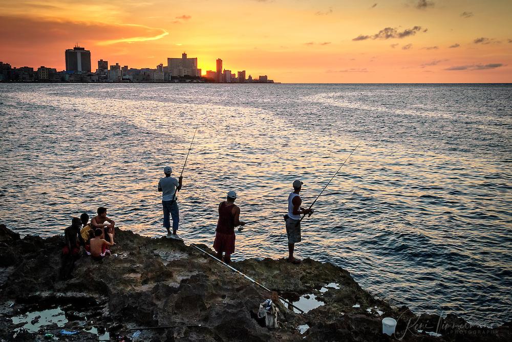 Men fishing at sunset