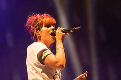 © Licensed to London News Pictures. 18/07/2014. Southwold, UK.   Lily Allen performing live at Latitude Festival 2014 on Day 1.  Lily Allen replaced Two Door Cinema Club as tonight's headline act  and has been receiving negative comments on twitter by disappointed Two Door Cinema Club fans.  Lily Allen replacing Two Door Cinema Club  was announced earlier this week as a result of Two Door Cinema Club's frontman Alex Trimble's ill health.   It was reported Trimble collapsed at an american airport.   The Latitude Festival is a British annual music festival.  Photo credit : Richard Isaac/LNP