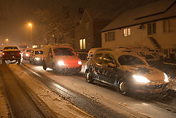 Licensed to London News Pictures. 12/01/2017. Caterham, UK.  Drivers queue as heavy snow forces traffic to a standstill on un-gritted roads in Caterham, Surrey, today (12/01/2017). Photo credit: Matt Cetti-Roberts/LNP