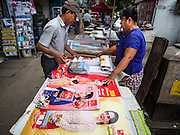 21 OCTOBER 2015 - YANGON, MYANMAR: Calendars featuring Burmese democracy icon Aung San Suu Kyi for sale on the street in Yangon. Suu Kyi's party, the National League for Democracy (NLD) is contesting a national election in Myanmar.  PHOTO BY JACK KURTZ