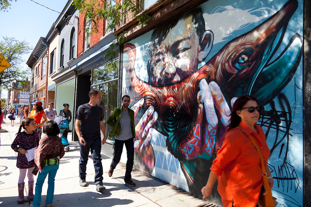Shops and street scenes along Queen West in Toronto. Graffiti art is a common site along Queen West.