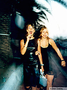 Two girls walking down the street one sucking a lolli pop Ibiza 1999