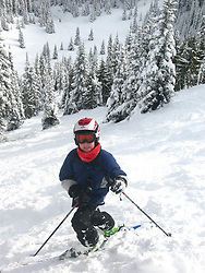 North America, United States, Washington, Crystal Mountain, boy on skis at top of steep hill  MR