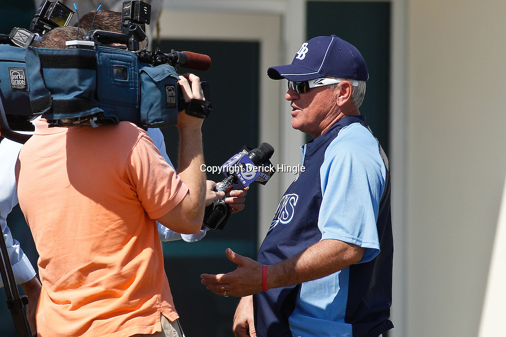 February 18, 2011; Port Charlotte, FL, USA; Tampa Bay Rays manager Joe Maddon talks to the media following a spring training practice at Charlotte Sports Park.  Mandatory Credit: Derick E. Hingle