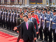 23 JULY 2015 - BANGKOK, THAILAND: NGUYEN TAN DUNG (center), Prime Minister of Vietnam,  and PRAYUTH CHAN-O-CHA, Prime Minister of Thailand, (left) walk back to the reviewing stand after reviewing soldiers in the honor guard at Government House in Bangkok. The Vietnamese Prime Minister and his wife came to Bangkok for the 3rd Thailand - Vietnam Joint Cabinet Retreat. The Thai and Vietnamese Prime Minister discussed issues of mutual interest.      PHOTO BY JACK KURTZ