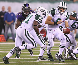Sept 13, 2011; East Rutherford, NJ, USA; New York Jets quarterback Mark Sanchez (6) hands the ball to New York Jets running back LaDainian Tomlinson (21) during the second half at the New Meadowlands Stadium.  The Baltimore Ravens defeated the Jets 10-9.