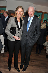 The HON.MICHAEL TOLLEMACHE and his wife CLARE at the Linley Christmas Party held at Linley, 60 Pimlico Road, London on 16th November 2011.