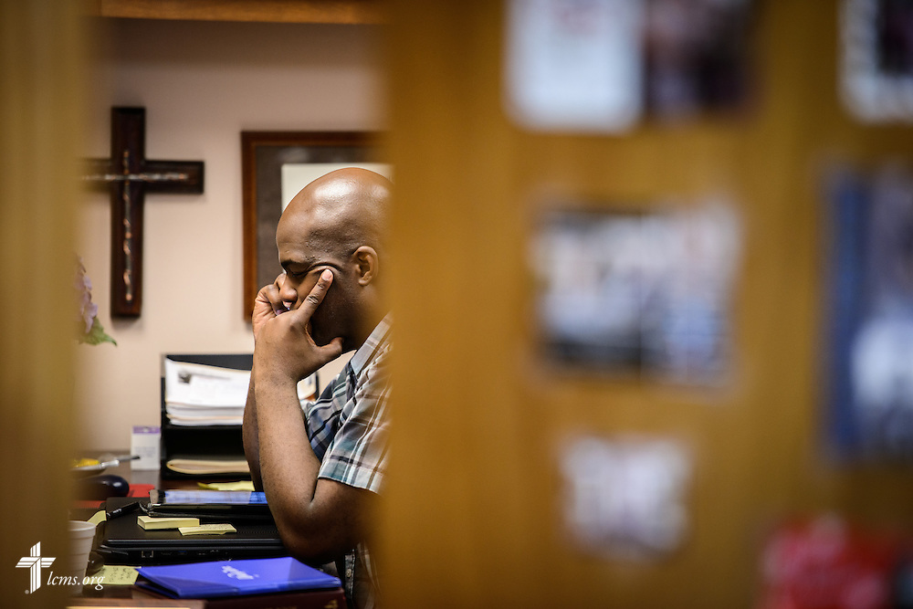 The Rev. Gregory T. Manning, pastor of Gloria Dei Lutheran Church, works in his office at the church on Wednesday, March 9, 2016, in New Orleans. LCMS Communications/Erik M. Lunsford