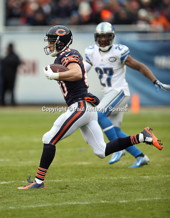 Chicago Bears wide receiver Marc Mariani (80) catches a third quarter pass for a gain of 22 yards while being chased by Detroit Lions free safety Glover Quin (27) during the NFL week 17 regular season football game against the Detroit Lions on Sunday, Jan. 3, 2016 in Chicago. The Lions won the game 24-20. (©Paul Anthony Spinelli)