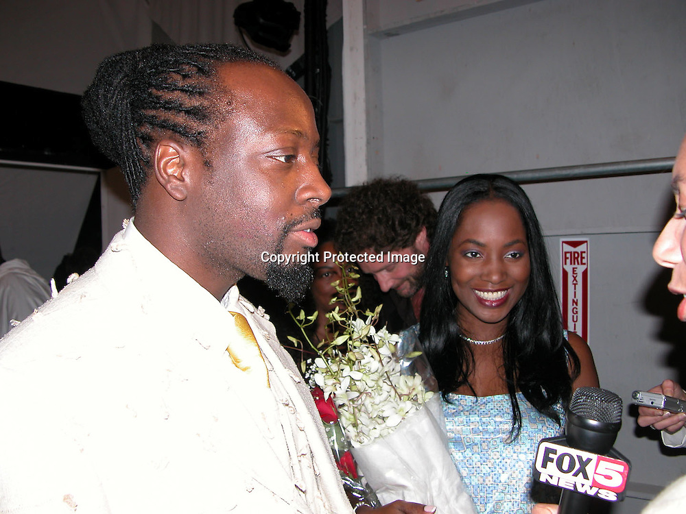 Wycleaf Jean &amp; wife Marie Claudinette Pierre-Jean<br />Fusha Fashion Show Front Row &amp; backstage<br />The Bryant Tent, Bryant Park<br />New York City, NY, USA<br />Saturday, September, 13, 2003 <br />Photo By Celebrityvibe.com/Photovibe.com