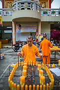 23 OCTOBER 2012 - HAT YAI, SONGKHLA, THAILAND:  Novice monks prepare for the end of the Vegetarian Festival at Wat Ta Won Vararum, a Chinese Buddhist temple in Hat Yai. The Vegetarian Festival is celebrated in Thai-Chinese communities throughout Thailand. It is the Thai Buddhist version of the The Nine Emperor Gods Festival, a nine-day Taoist celebration celebrated in the 9th lunar month of the Chinese calendar. For nine days, those who are participating in the festival dress all in white and abstain from eating meat, poultry, seafood, and dairy products. Vendors and proprietors of restaurants indicate that vegetarian food is for sale at their establishments by putting a yellow flag out with Thai characters for meatless written on it in red.   PHOTO BY JACK KURTZ