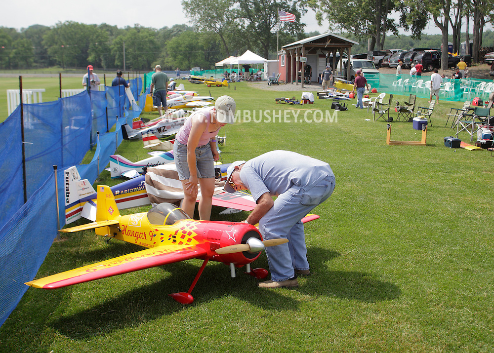New Hampton, New York - People look at a remote controlled airplane at a fly-in sponsored by the Wawayanda Flying Club at  on June 5, 2010.