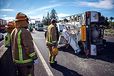 Auckland-Concrete truck rolls blocking motorway off ramp