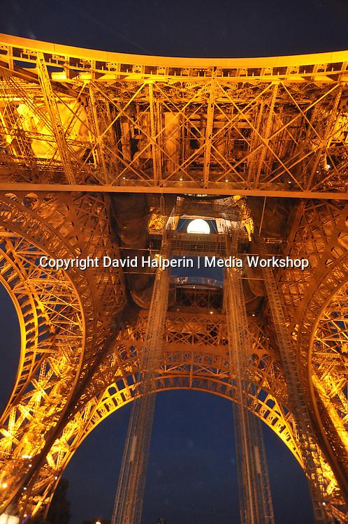 Eiffel tower, illuminated, evening, underside detail