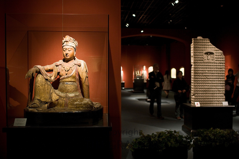 Painted and gilded wooden Buddha figure of Bodhisattva on display in the Shanghai Museum, China
