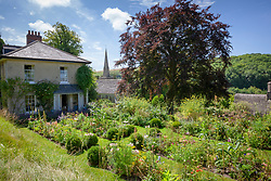 General view of the garden and church at The Old Parsonage