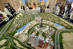 Model of new luxury property development at Falconcity of Wonders at property trade fair in Dubai United Arab Emirates