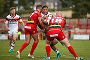Bradford Bulls winger Omari Caro (18) is stopped by Dewsbury Rams hooker Dom Speakman (17) and Dewsbury Rams prop Jack Teanby (18) during the Kingstone Press Championship match between Dewsbury Rams and Bradford Bulls at the Tetley's Stadium, Dewsbury, United Kingdom on 10 September 2017. Photo by Simon Davies.
