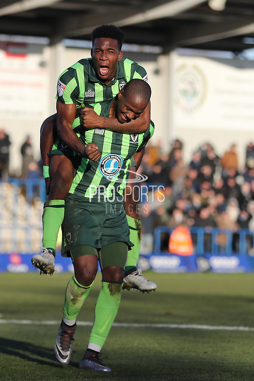 AFC Wimbledon striker Dominic Poleon (10) celebrates AFC Wimbledon striker Tom Elliott (9) winner scores a goal 3-4 during the The FA Cup match between Curzon Ashton and AFC Wimbledon at Tameside Stadium, Ashton Under Lyne, United Kingdom on 4 December 2016. Photo by Stuart Butcher.