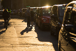 """Black taxi drivers from the United Cabbies Group (UCG) bring Fleet Street to a standstill as they protest """"fairer enforcement of taxi and private hire vehicle regulations, which cover minicabs and Uber cars""""."""