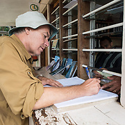 A climber signs the log book at the ranger station at Mweka Gate after finishing an expedition climbing Mt Kilimanjaro.