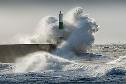 &copy; London News Pictures. 08/12/2017. Aberystwyth, UK.<br /> The southern edge of Storm Caroline, with winds gusting between 40 and 60 mph, is still impacting on the harbour lighthouse  sea defences  in Aberystwyth, Ceredigion , west Wales UK. Photo credit: Keith Morris/LNP