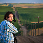 Jose M. Cabrera poses for a portrait along a dirt road in the farm country of the Palouse Region of Washington.