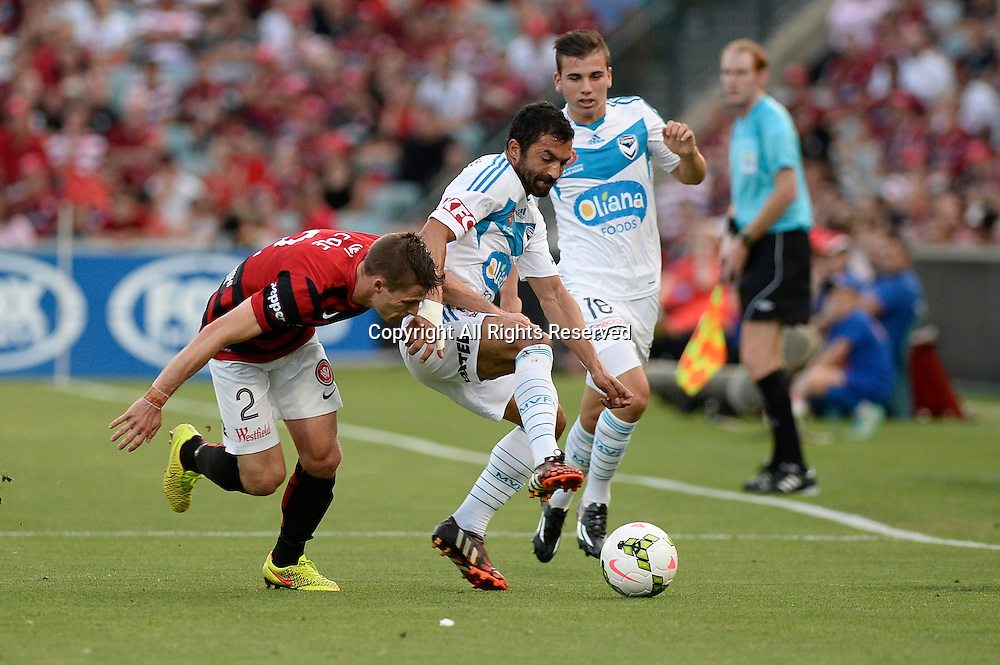 06.01.2015. Sydney, Australia. Hyundai A-League Round 14. Western Sydney Wanderers FC v Melbourne Victory FC. Wanderers defender Shannon Cole and Victory midfielder Fahid Ben Khalfallah.Victory won the game 2-1.
