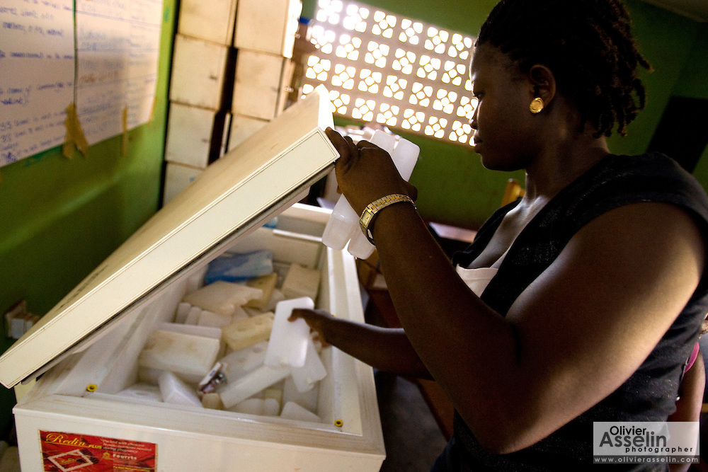 A health pulls ice packs from a freezer to fills ice boxes that will be used to carry polio vaccines at the beginning of a second day of vaccination during a national polio immunization execise in Savelugu, northern Ghana on Friday March 27, 2009.